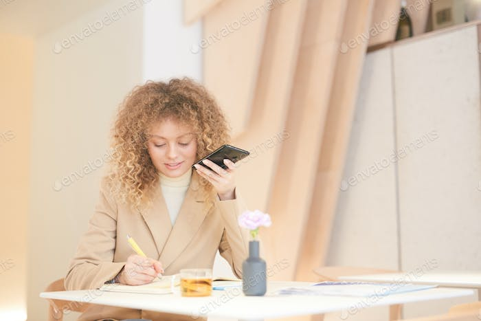 Young Woman Studying in Cafe