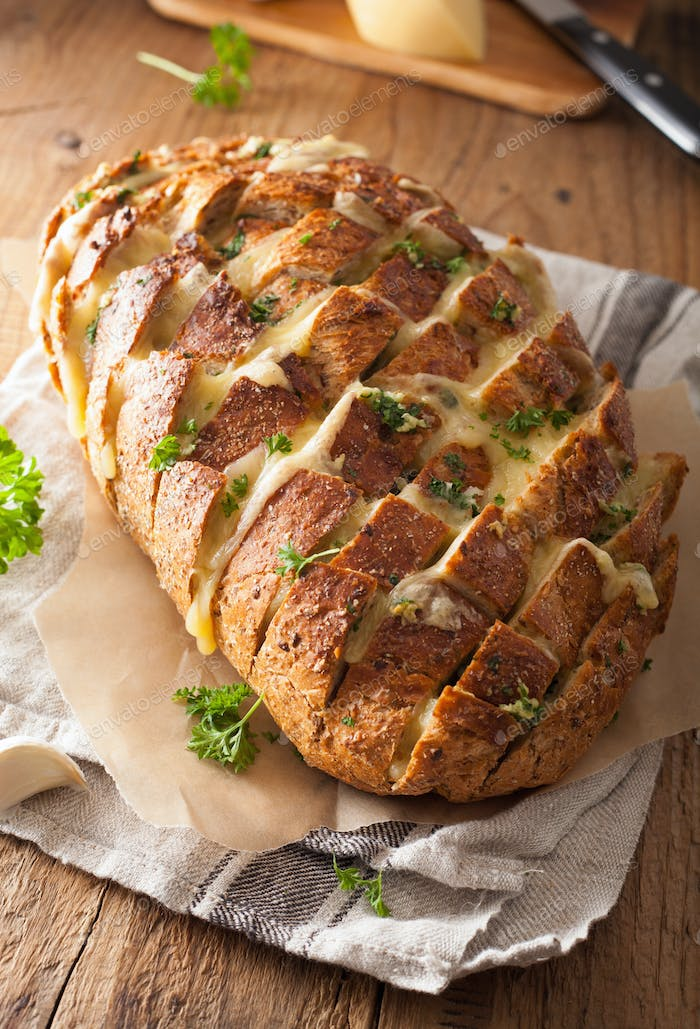 baked party bread with melted cheese butter herbs