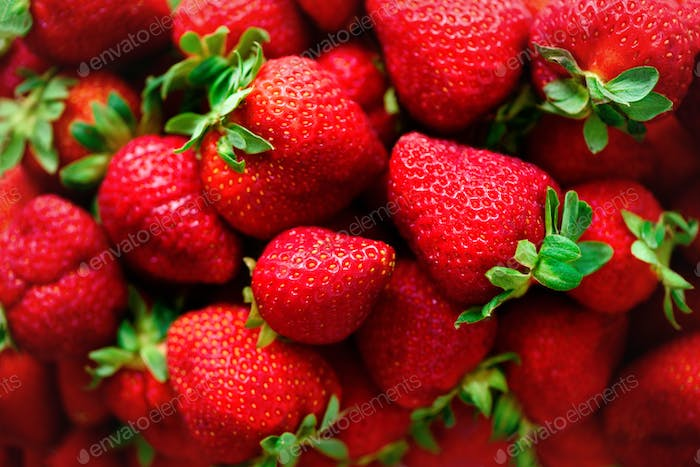 Organic strawberries background with copy space. Top view. Vegan and vegetarian concept. Berries