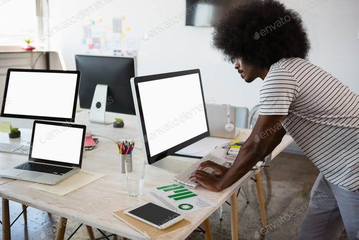Man using computer while working at office