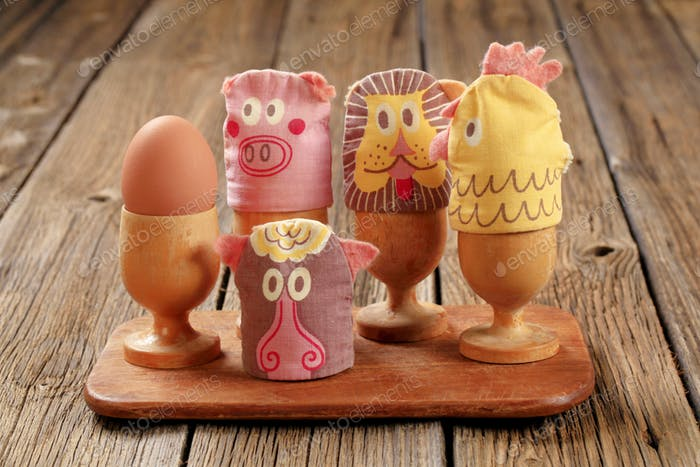 Funny egg cosies for boiled eggs