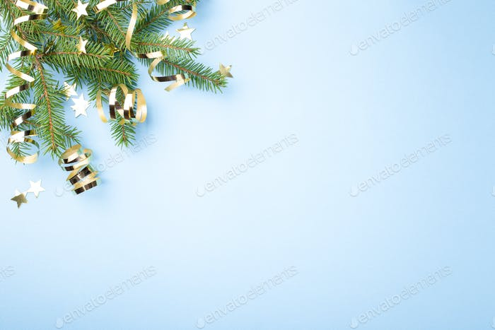 Fir Branches with Golden Decorations on Blue Background.