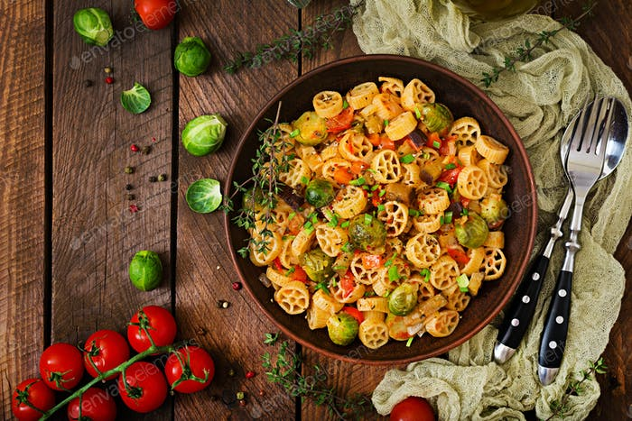 Vegetarian Vegetable pasta Rocchetti with brussels sprouts, tomato, eggplant