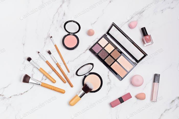 Flat lay with set of professional decorative cosmetics, makeup tools