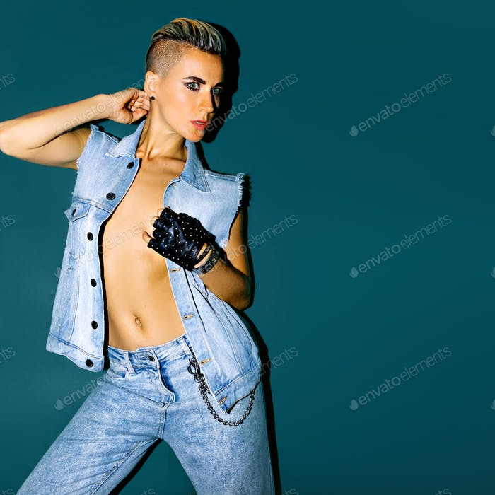 Tomboy girl in denim look. fashion jeans clothes