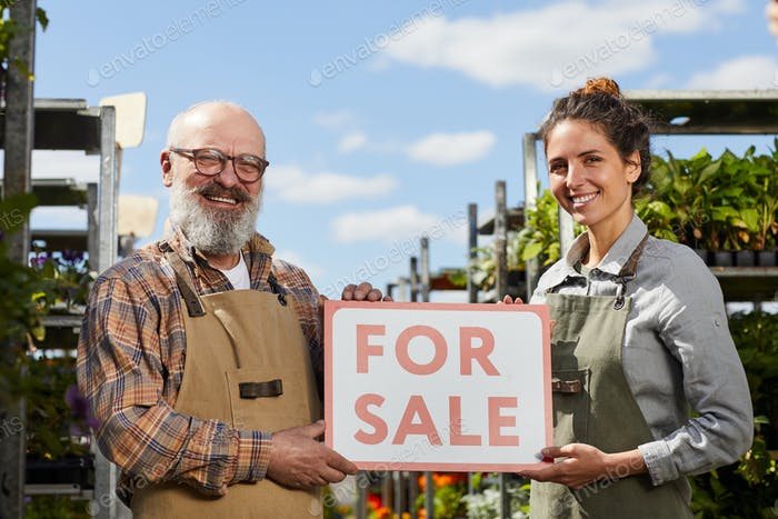 Workers Holding For Sale Sign at Plantation