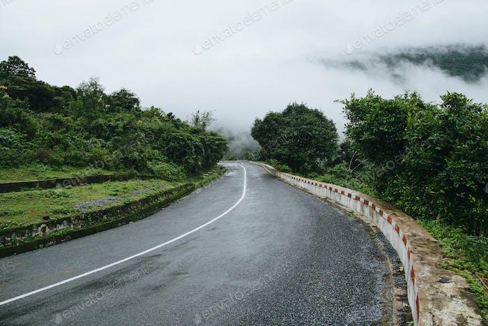 empty asphalt road in beautiful mountains, Hai Van Pass, Vietnam