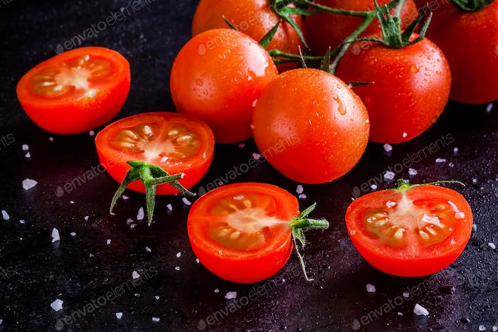 fresh organic cherry tomatoes with drops and sea salt