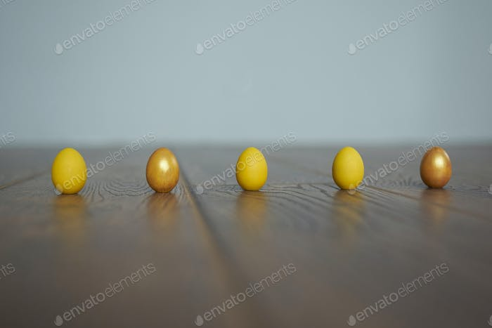 Eggs in a row on the background