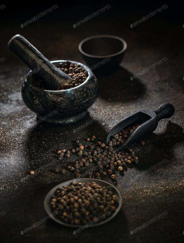 Raw organic black peppercorns