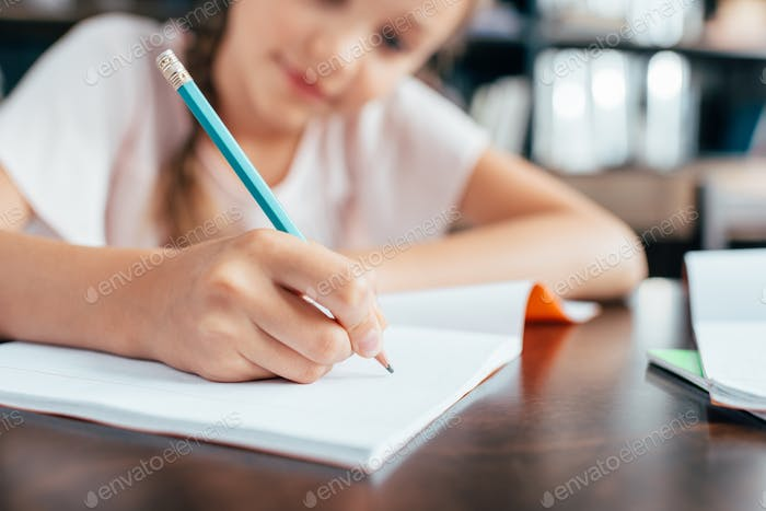 cute cute little girl doing homework