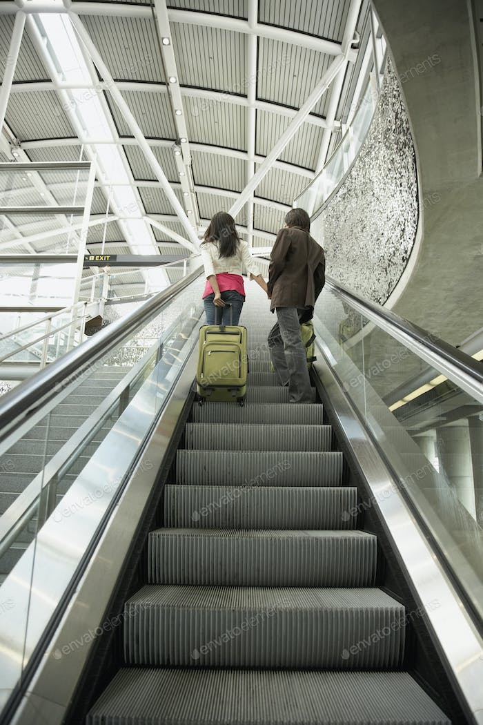 Rear view of couple on escalator