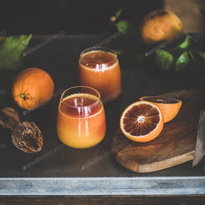 Two glasses of blood orange juice or smoothie, square crop