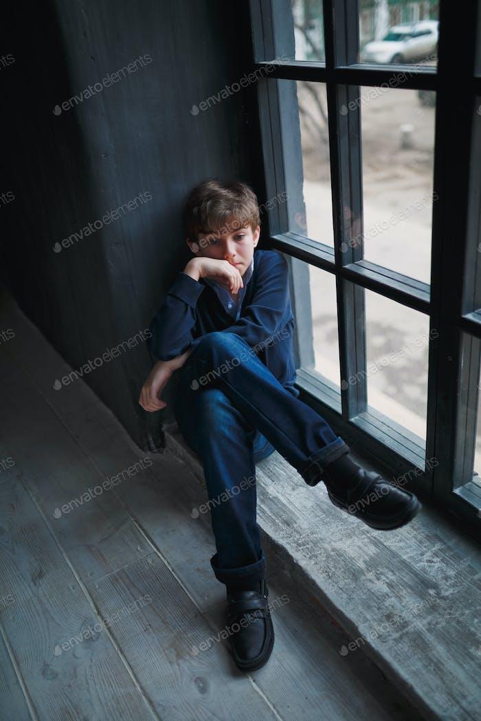 Sad teenager boy.
