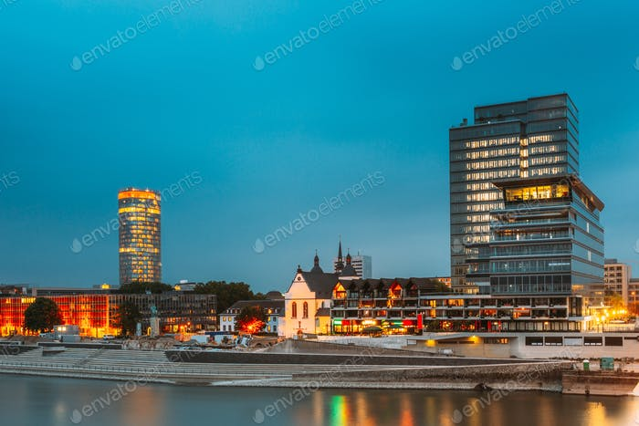 Cologne, Germany. Modern Building On Embankment During Summer Evening Night