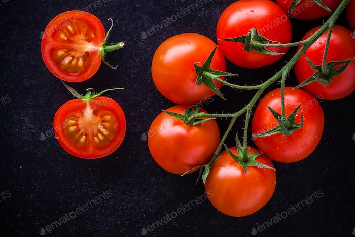 a bunch of fresh organic cherry tomatoes