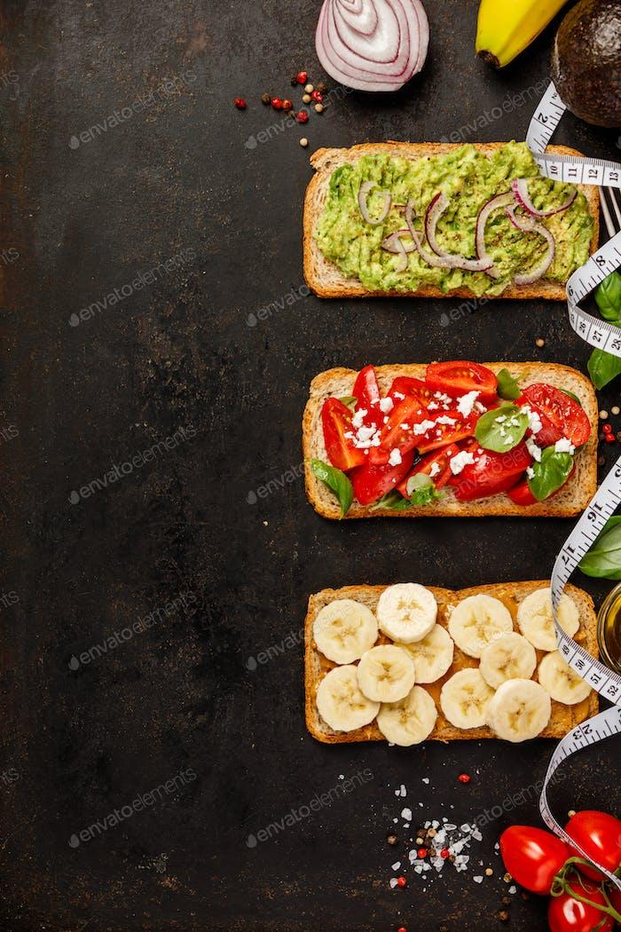 Healthy sandwicheson dark background