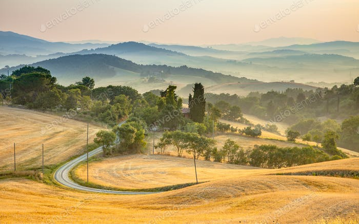 Tuscany foggy hills panorama view with winding road