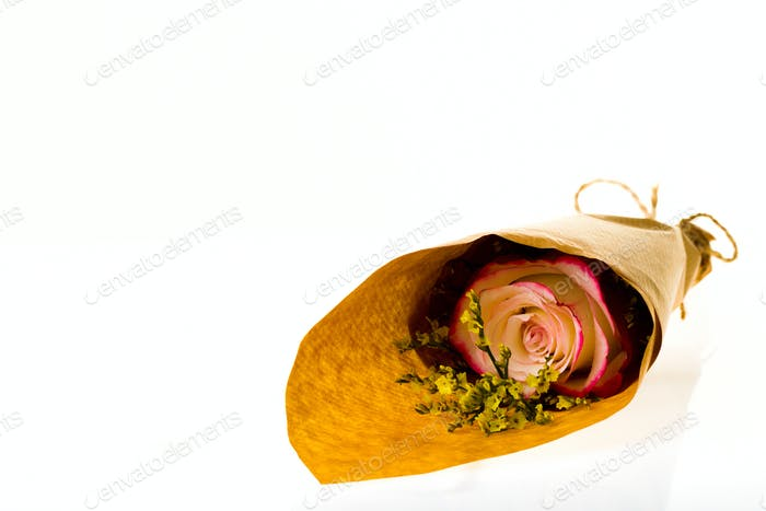 "Bouquet of flowers ""Limonium"" and ""Sweetness"" Rose in parchment on a white background"