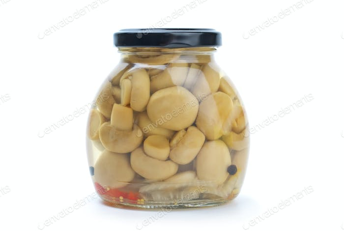 Glass jar with marinated champignons