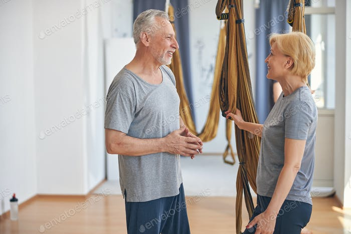 Two sporty people standing at a gym