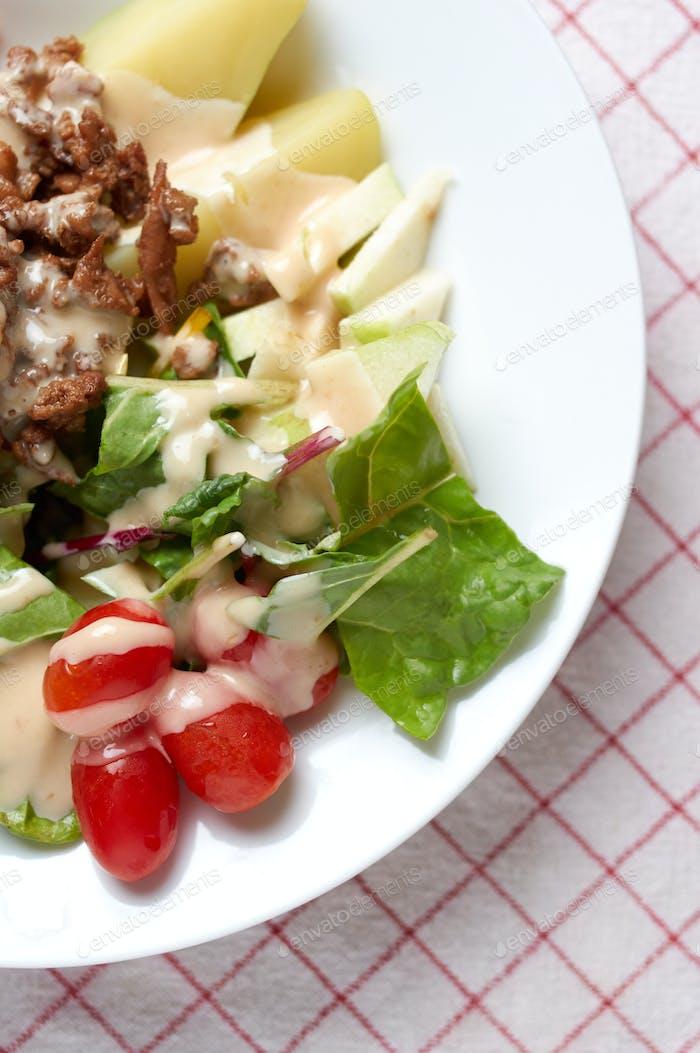Healthy salad with caramelized pork chop