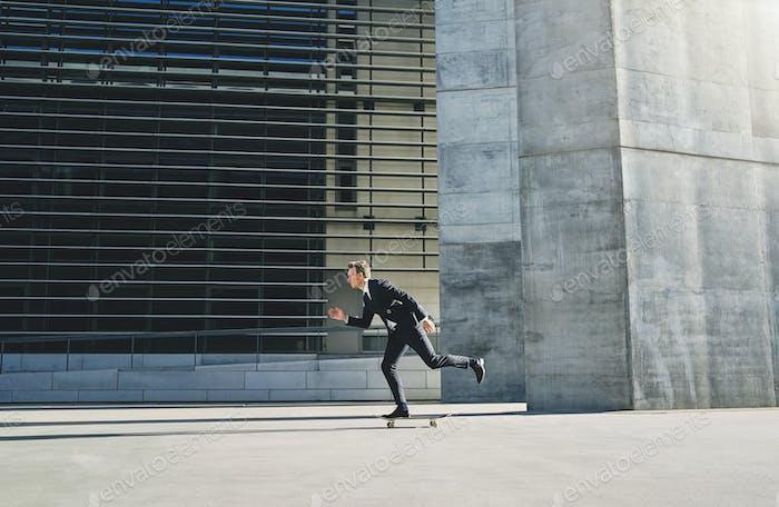 Man in black suit on a skateboard