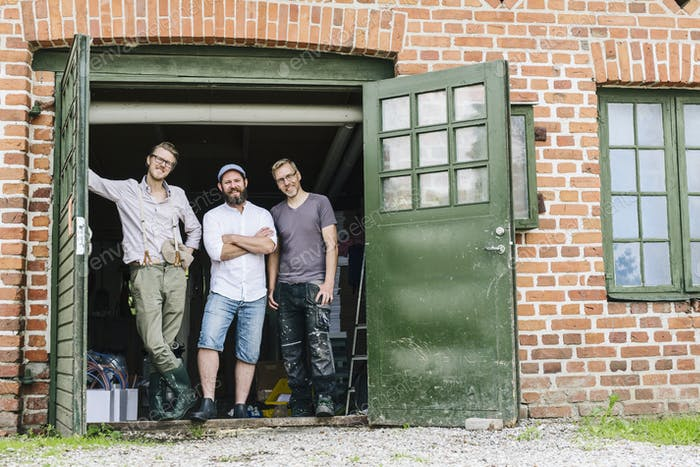 Portrait of three brewery workers