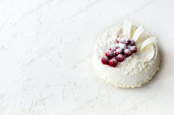 Delicious cheesecakes with cranberries, cherries, coconut flakes and white chocolate on light