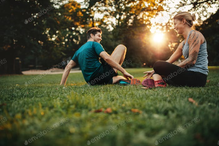 Couple relaxing after physical training session