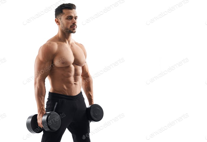 Shirtless male bodybuilder holding dumbbells
