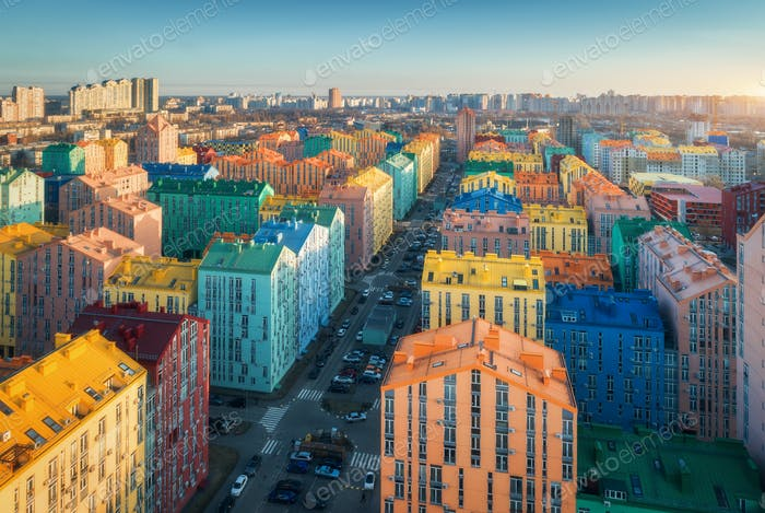 Aerial view of the colorful buildings in european city at sunset