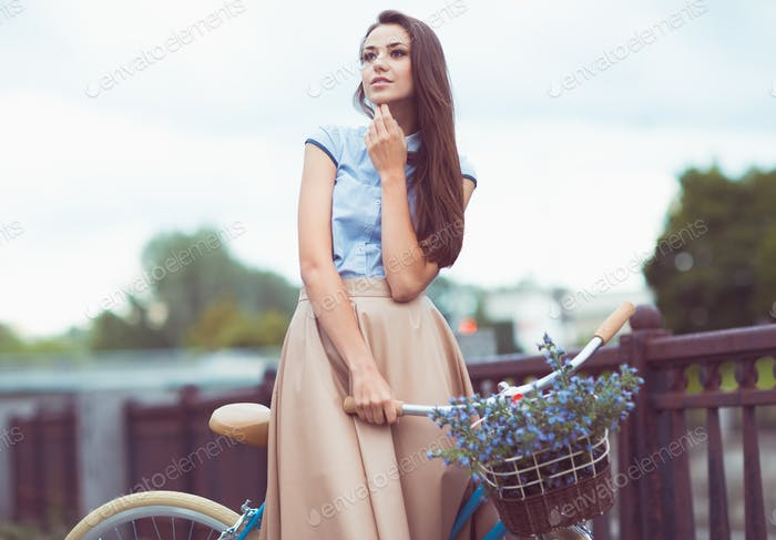 Young beautiful, elegantly dressed woman, summer and lifestyle