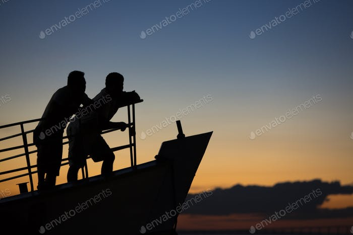 Sunset and silhouettes on boat cruising the Amazon River, Brazil