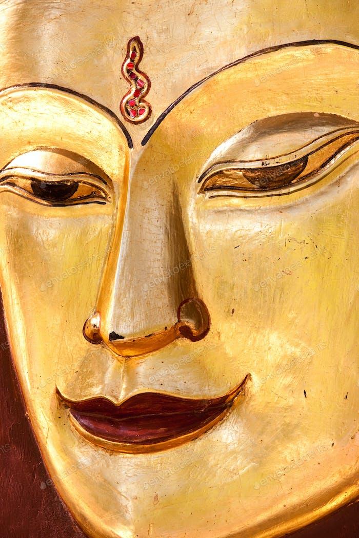 Sculpture of a Buddha. Close up of the face, Mandalay, Myanmar