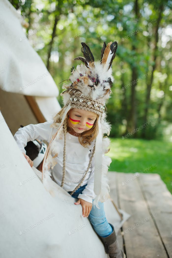 little funny girl with native american costume