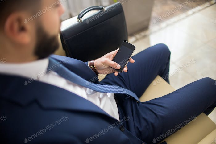 Businessman Waiting in Lobby