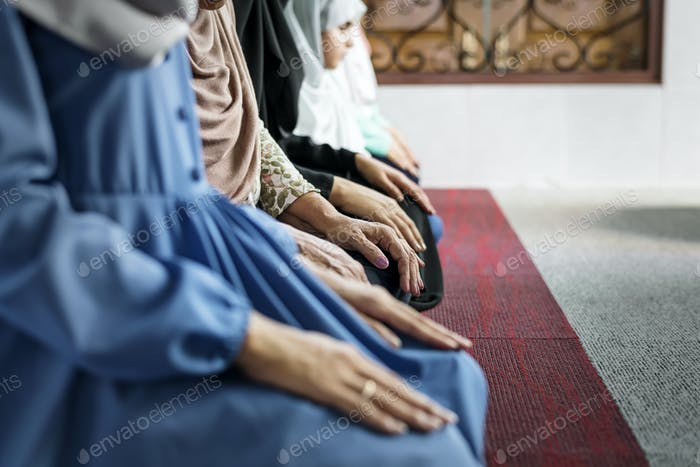 Muslim women meditating in the mosque during Ramadan