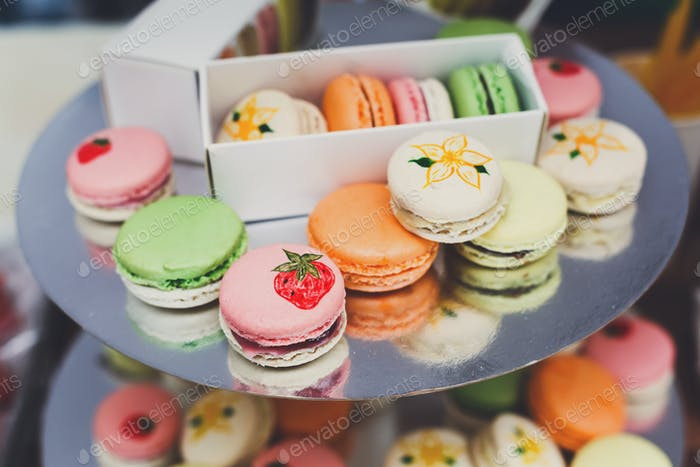 Colorful macaron cookies on bar for sale