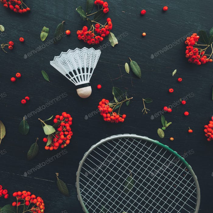 Flat lay badminton racquet and shuttlecock