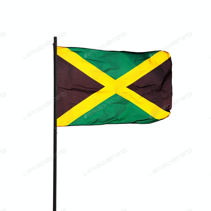 Jamaica flag in the wind and its pole on white. Photo.