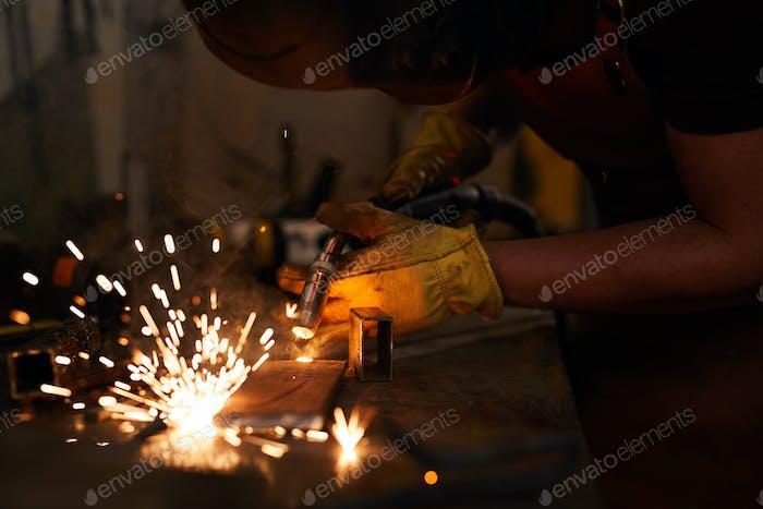 Laborer welding metal piece