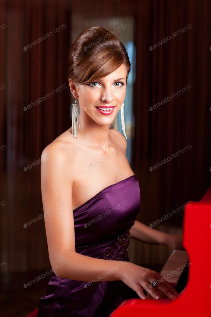 young elegant woman playing the piano