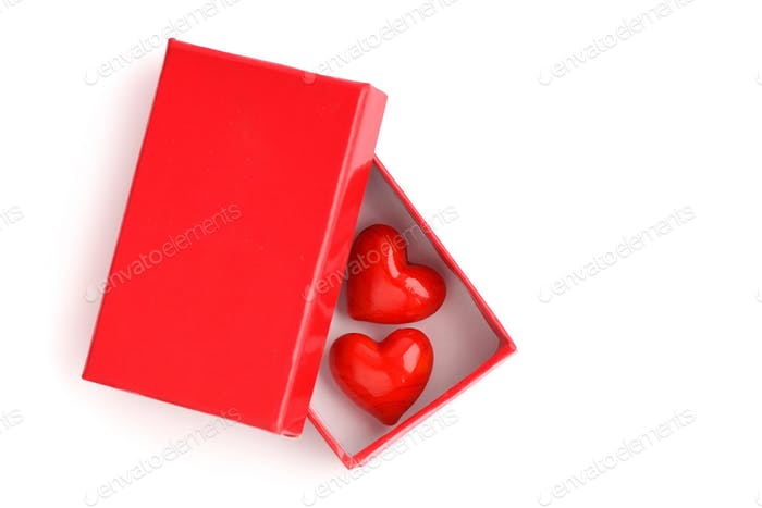Two hearts in a red gift box on a white background. The Valentin