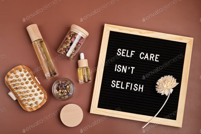 Self care is not selfish. Felt letter board with body and mind care products. Love yourself