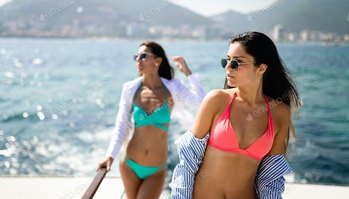 Beautiful happy women in sexy bikini enjoying summer vacation