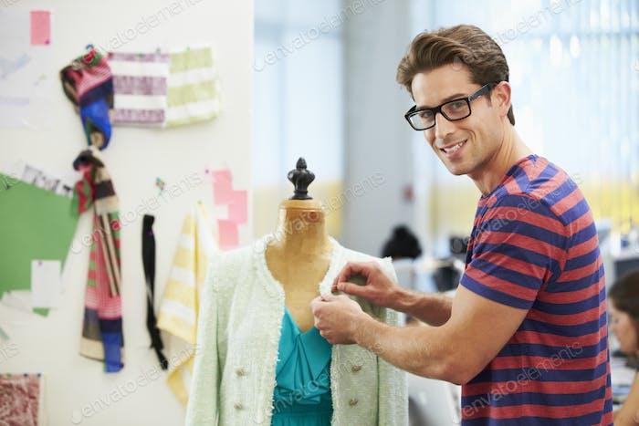 Male Fashion Designer In Studio
