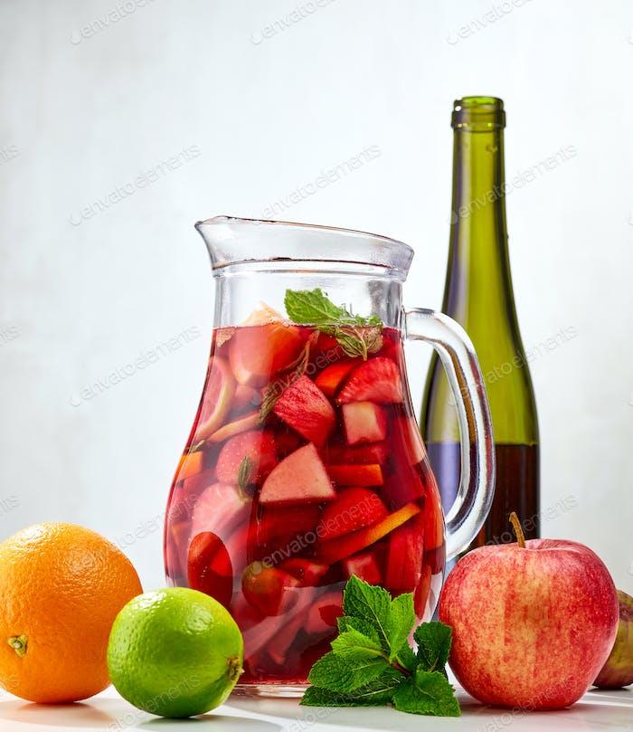 sangria jug and ingredients