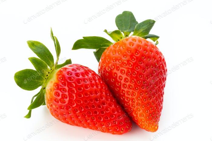 Fresh strawberries close up on white background.