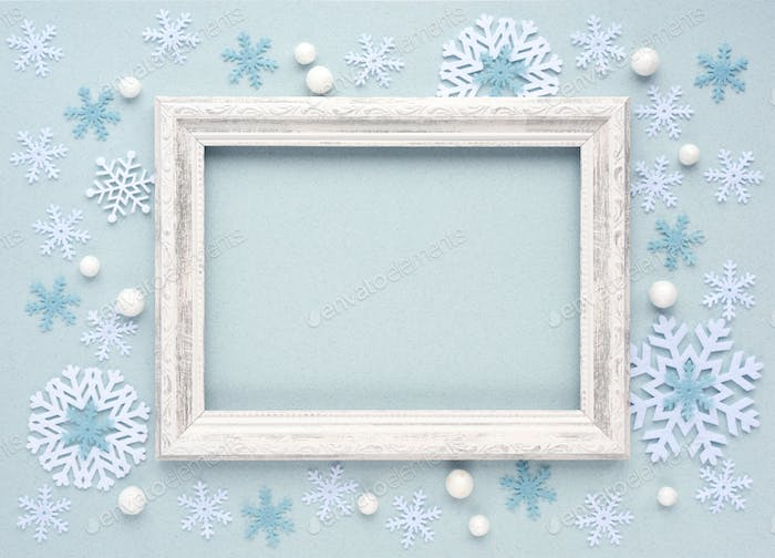 Christmas background. Photo frame and snowflakes on white background. Flat lay, top view, copy space